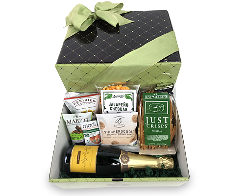 Box containing half bottle of champagne along with snacks