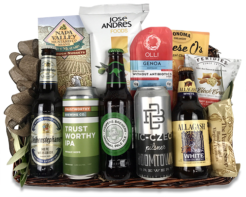 A basket weave tray with beers, cheese and snacks