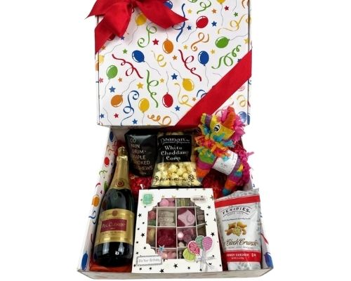 A gift box complete with a Personal Pinata, a half bottle of French Sparkling wine, Petits Fours Cakes, a Birthday Cake Chocolate Bar