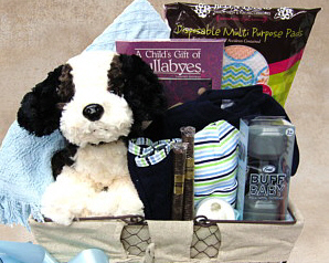 wire basket with cotton baby blanket, baby rattle, lullabye CD, cap, washcloth, chocolate cigars, stuffed animal and more