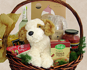 a basket for baby and family that includes foods like soup, pasta sauce, pasta as well as fine baby items