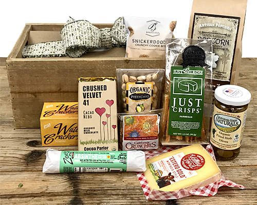 a wood crate containing a selection of California craftsman foods as described.