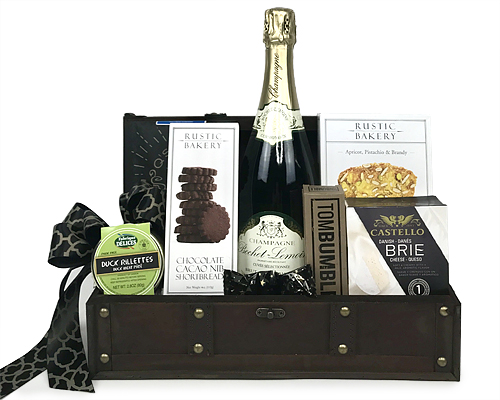 a wood box holds champagne, cheese and other foods
