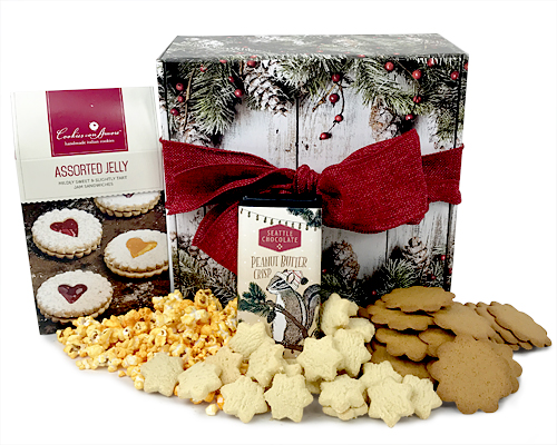 A pinecone box filled with a variety of cookies, popcorn and chocolate