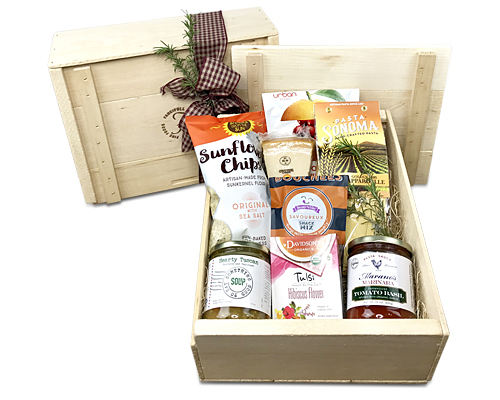 a wood crate with a lid and a pretty bow filled with the foods listed in the product description