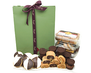 A pretty paper gift bag filled with Kosher baked goods