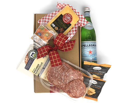 a display of Italian inspired foods that come in a simple gift box
