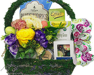 Spring has sprung in this basket filled with flowers and other treats.