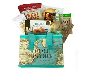 a tote with a map of the world motif and the words eat well, travel often filled with foods from various countries