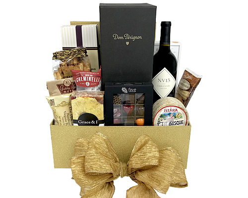 Gold box with Dom Perignon, Cain Cuvee, chocolates, cheese, nuts and more