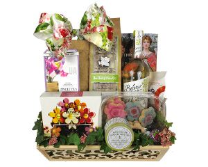 a basket of flower shaped cookies, chocolate, flower growing kit, popcorn and other treats