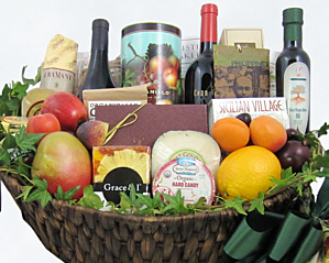 A large brown basket with two big red wines and the delicious foods listed in the description. Click to go to that page.