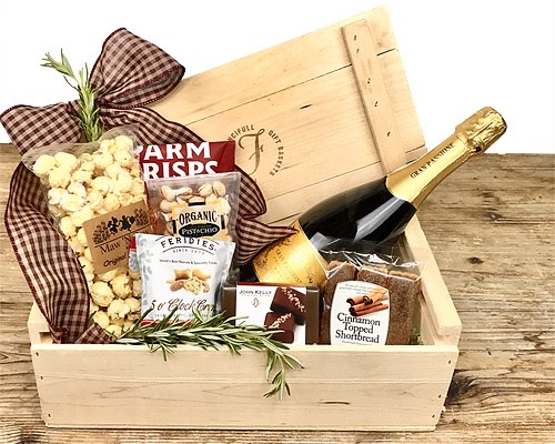 a wood crate with a lid filled with cheese, wine and other foods as described in the text