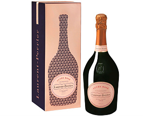 a pink Laurent Perrier Rose gift tin with a bottle of Laurent Rose Perrier beside it