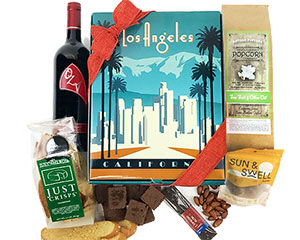 a deco styled box with a graphic of the LA skyline with California made wine and delicious products - click here for the description