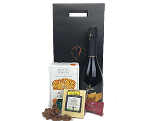 a tall gift bag with the Fancifull logo with prosecco, cheese, crostini, nuts and chocolate - click for details