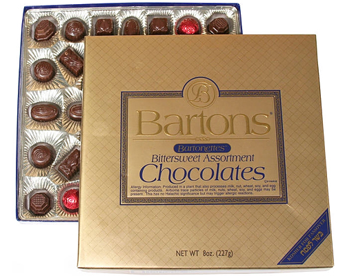 a gold box of kosher chocolates by Bartons