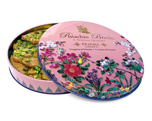 a round tin containing pistachio brittle