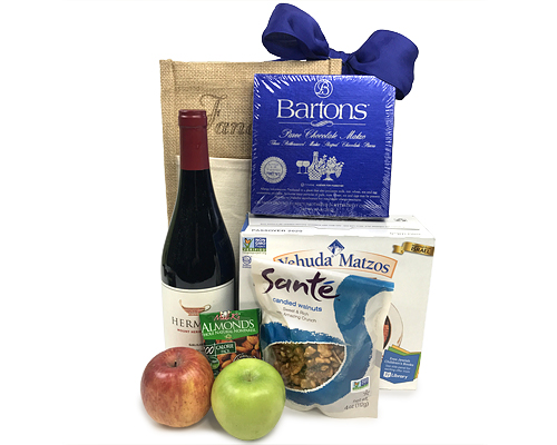 jute tote filled with kosher wine, chocolate matzos, walnuts, apples, almonds and matzos