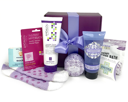 a floral decor box with slippers, bath gel, candle, lotion and other items