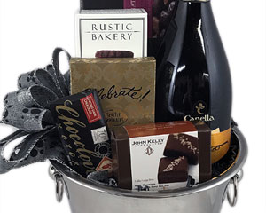 an ice bucket containing a bottle of prosecco, chocolates and chocolate cookies