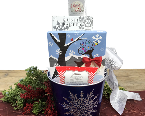 A blue snowflake container holds Italian Candy, Snowflake Cookies, White Chocolate Oreos and Peppermint Candy