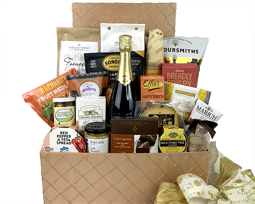 A hand-crafted champagne in a large basket accompanied with fine cheese, chocolate, olives, almonds and other delights.