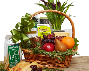 a wicker basket containing fruits , foods and flowers