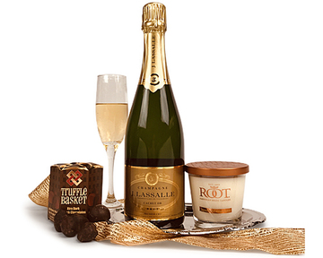 a hand-crafted champagne with chocolates and a candle on a serving tray