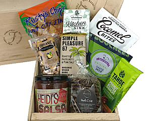 a wood crate is shown with vegan snacks and cookies