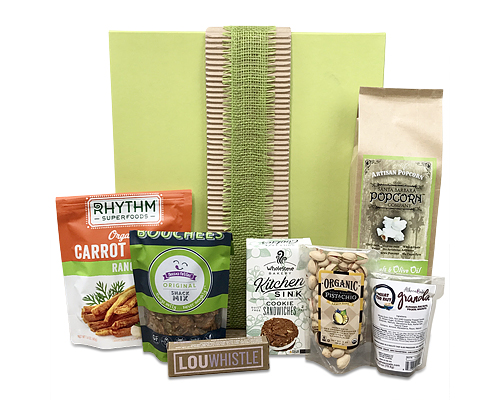 a green gift boxshown closed with a burlap ribbon stands behind a dilplay of the packaged good within