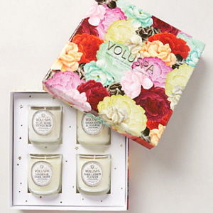 Four Voluspa candles in a floral motif gift box.