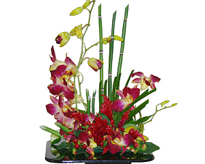 a zen garden inspired arrangement with bamboo ans dendrobiums